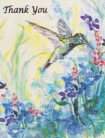 Hummingbird and blue flowers
