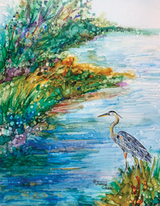 Heron beside stream