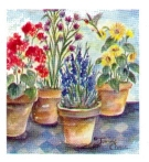 Four potted plants with hummingbird